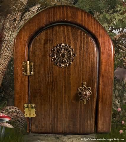 Fairies don t grow on trees shootthescribe wordpress com for Wooden fairy doors that open